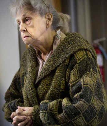 Dixie Freeman, who does not have a car or phone needed to evacuate from her home in Valley Park, Mo., pauses Dec. 30 at City Hall as floodwaters approached the levee capacity. She needed help to get her 94-year-old disabled mother, Nora Dell, two dogs and a cherished cockatiel out of the house. She went to City Hall to ask for help with the animals and transportation. (CNS photo/Lisa Johnston, St. Louis Review)