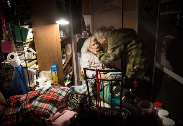 Dixie Freeman (right), of Valley Park, Mo., comforts her 94-year-old disabled mother, Nora Dell, Dec. 30 as floodwaters approached their home. (CNS photo/Lisa Johnston, St. Louis Review)