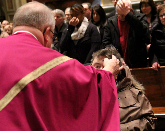 Margaret Ann Meyer receives ashes from Msgr. Daniel Kutys.