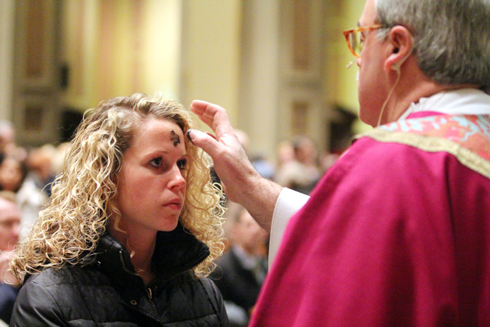 Amie Klapach, from Saint Vincent De Paul Chuch in Richboro, receives ashes marking the beginning of the Season of Lent for Christians throughout the world.