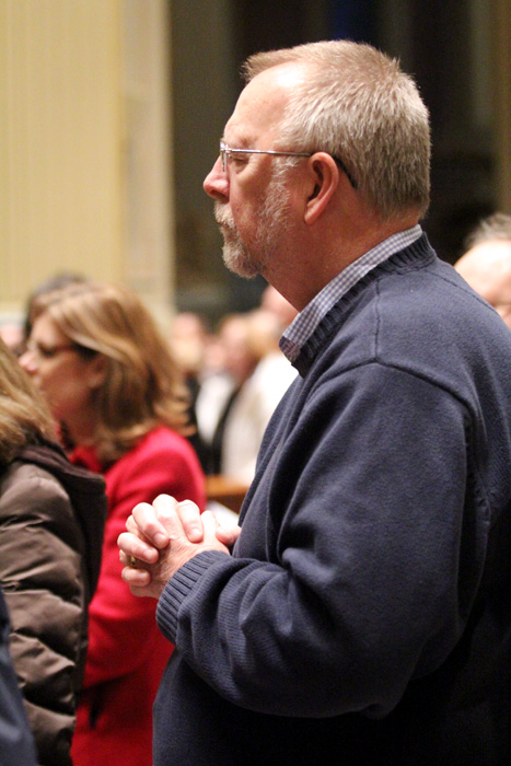 Kevin Kirby, from Saint Agnes Church in West Chester, prays during Mass on Ash Wednesday.
