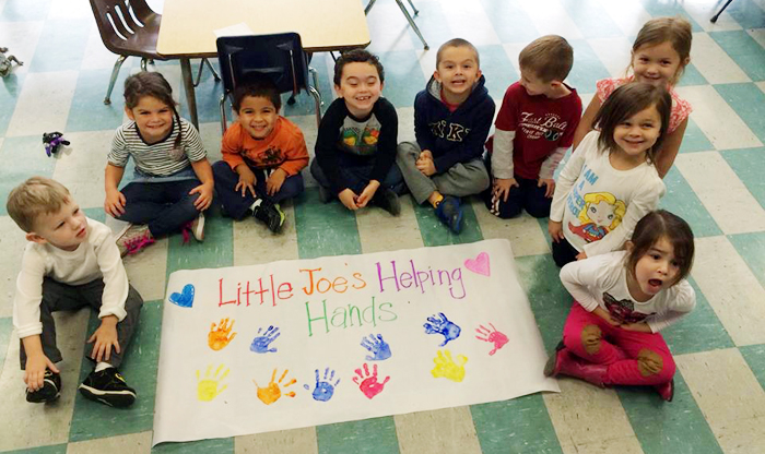 The pre-K class of St. Joseph the Protector School in Glenside is proud of their school's Helping Hands service project.