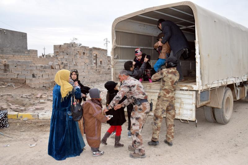 Iraqi soldiers evacuate families from Ramadi, Iraq, Feb. 3, after the city was recently recaptured by Iraqi forces. A European bishops' commission has welcomed a move by the European Parliament to classify atrocities and religious cleansing by the Islamic State as genocide. (CNS photo/Reuters)