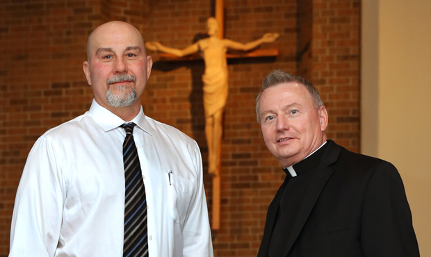 Father Neil Kookoothe, pastor of St. Clarence Parish in North Olmsted, Ohio, and former death-row inmate Joe D'Ambrosio pose for a photo Feb. 11. (CNS photo/William Rieter)