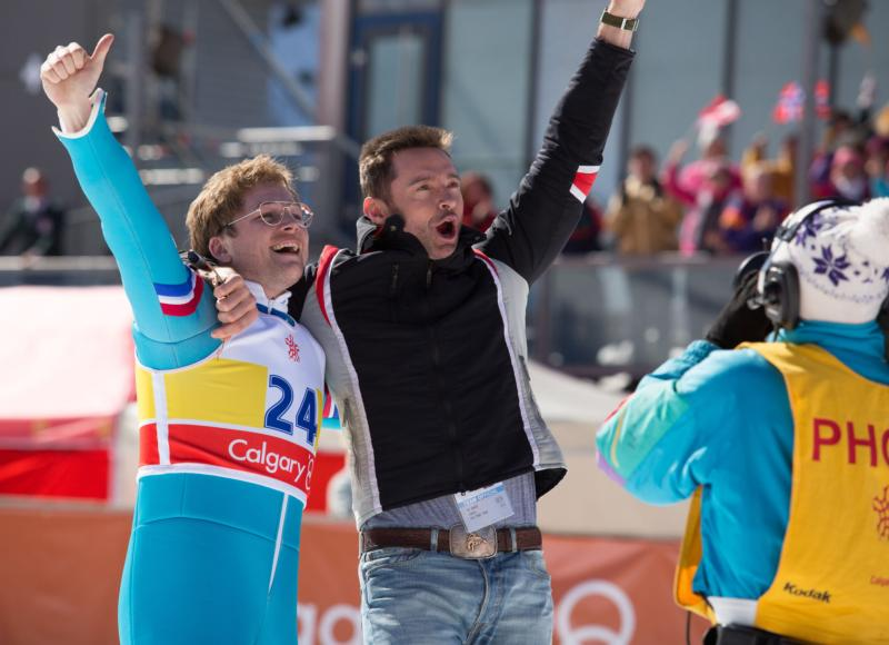 "Taron Egerton and Hugh Jackman star in a scene from the movie ""Eddie the Eagle."" (CNS photo/Twentieth Century Fox)"