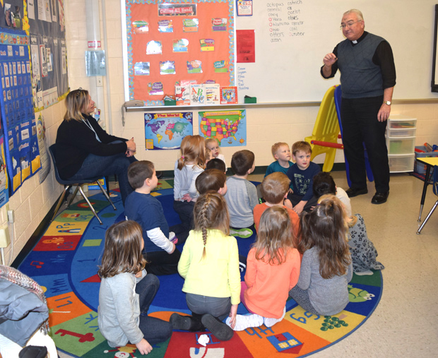 Father Paul Brandt talks to the pre-school children about Ash Wednesday and Lent.