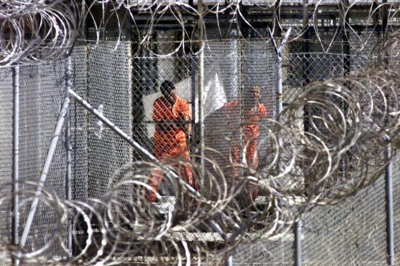 Alleged al-Qaida and Taliban combatants captured in Afghanistan are seen in the detention center at Guantanamo Bay, Cuba, in this Jan. 27, 2002 file photo. (CNS photo/AP Pool via EPA)
