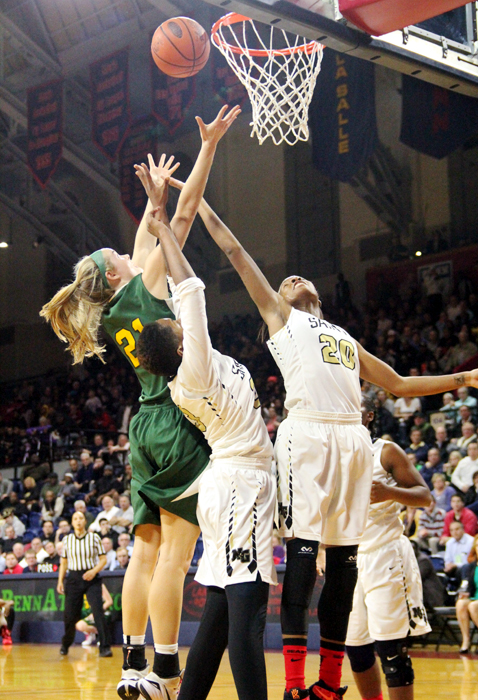 Wood #21 Bailey Greenberg senior co-captian gets the rebound