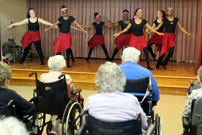 Students from John W. Hallahan Catholic Girls' High School perform a small variety show for the residents of Holy Family Home.