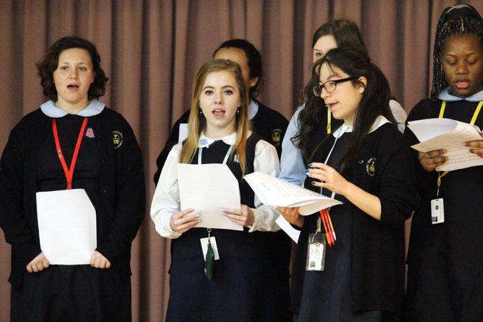 John W. Hallahan Catholic Girls' High School chorus memebers perform for residents of Holy Family Home.