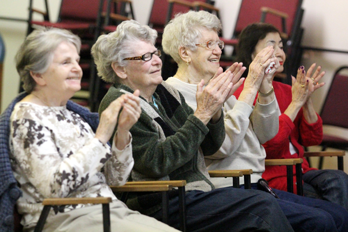 Residents of Holy Family Home, a residential facility for elderly poor in the City of Philadelphia that is run by the Little Sisters of the Poor, clap and sing along as students from John W. Hallahan Catholic Gilrs' High School perform.