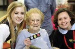 Margie Sonnie, Hallahan class of '42, was particularly happy to have Anna Hanlon, class of '18, and Maura Hrynczyszyn, class of '16, and their fellow classmates visit and perfrom where she resides at Holy Family Home.
