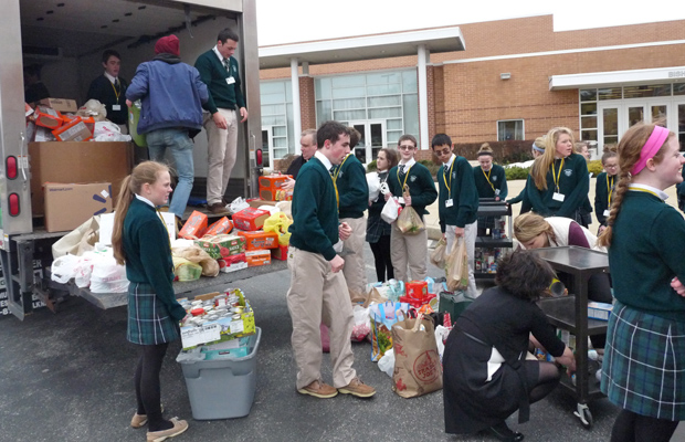 Bishop Shanahan students load up the 8,100 non-perishable canned and packaged food items they collected for the Chester County Food Bank for distribution, with the help of Shanahan alumnus Derek Fiorenza, founder of Fiorenza's Food For Friend. It was all part of Global Awareness Month at the Downingtown Catholic high school.