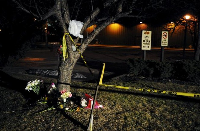 Flowers are placed at a makeshift memorial Feb. 22 near the Cracker Barrel restaurant in Kalamazoo, Mich., where one person died in a random shooting. Five other people also were killed and two others were wounded during the Feb. 20 shootings. (CNS photo/Mark Kauzlarich, Reuters)