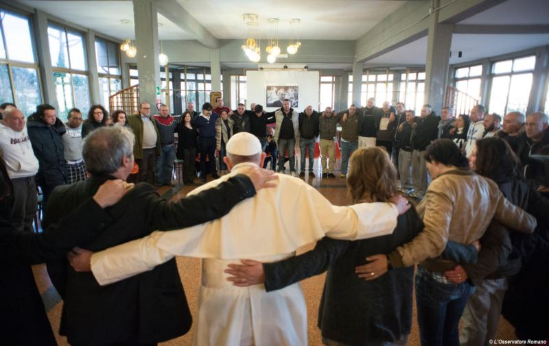 Pope Francis visits the San Carlo Community, a Catholic-run drug rehabilitation center on the outskirts of Rome near Castel Gandolfo, Italy, Feb. 26. The pope encouraged the 55 patients to trust God's mercy to keep them strong. (CNS photo/L'Osservatore Romano)