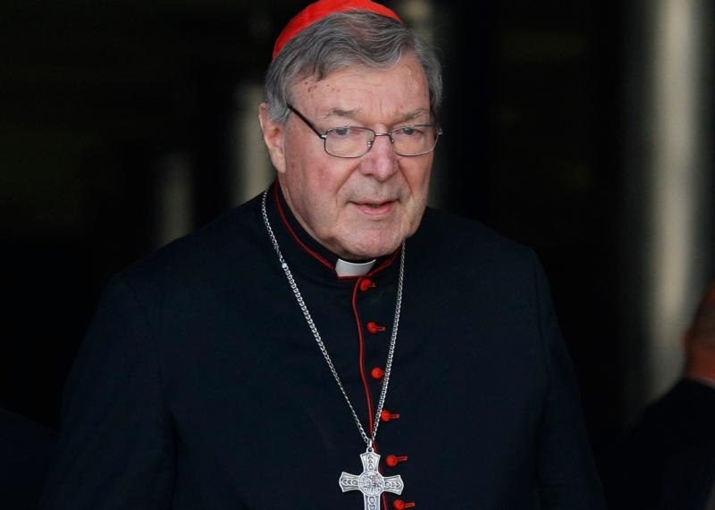 Australian Cardinal George Pell is seen in this Oct. 6, 2014 file photo at the Vatican. The Australian cardinal called for an inquiry into the leaking of accusations that he is under police investigation for the alleged abuse of minors. (CNS photo/Paul Haring)