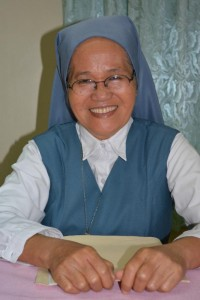Sister Porferia Ocariza, a member of the Daughters of St. Paul, poses for a photo Feb. 19 in Pasay City, Philippines. Sister Ocariza helped lead the rosary during the People Power uprising in the Philippines 30 years ago to oust dictator Ferdinand Marcos. (CNS photo/Simone Orendain)
