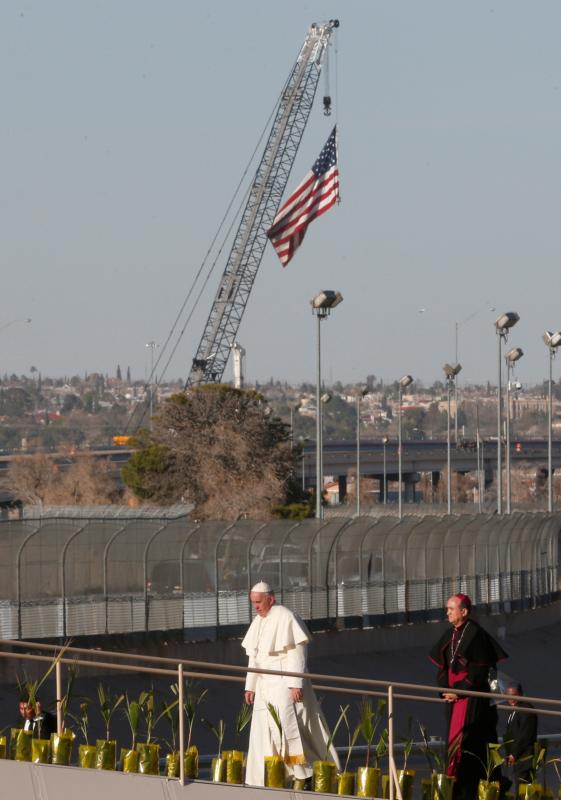 Pope Francis walks forward to pray at a cross on the border with El Paso, Texas, in Ciudad Juarez, Mexico, Feb. 17. (CNS photo/Paul Haring)
