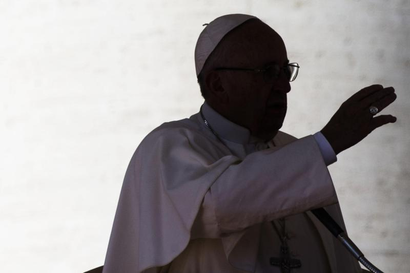 A silhouette of Pope Francis is seen in St. Peter's Square at the Vatican Feb. 20. For a Christian, talk is cheap; the faith requires concretely doing God's will and serving the least as well as those around you, Pope Francis said at his morning Mass Feb. 23.(CNS photo/Angelo Carconi, EPA)