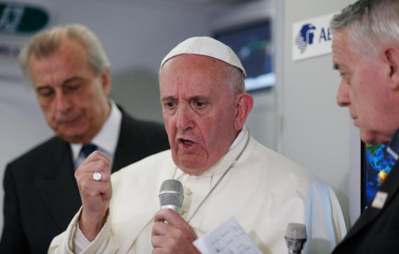 Pope Francis answers questions from journalists aboard his flight from Ciudad Juarez, Mexico, to Rome Feb. 17. (CNS photo/Paul Haring)