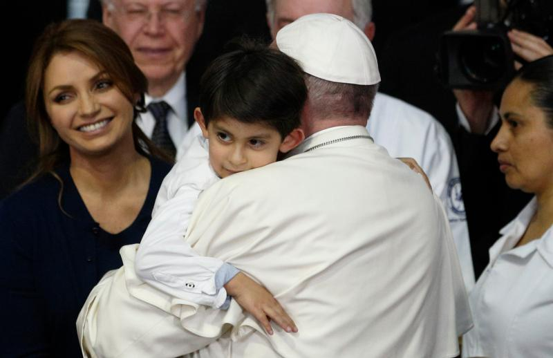 Pope Francis embraces a boy as he visits the Federico Gomez Children's Hospital of Mexico in Mexico City Feb. 14. At left is Mexico's first lady Angelica Rivera. (CNS photo/Paul Haring)
