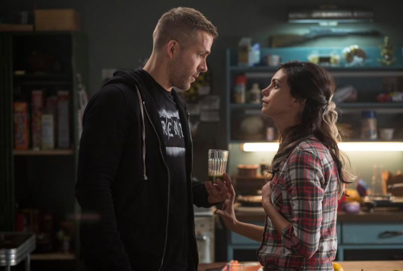 "Ryan Reynolds and Morena Baccarin star in a scene from the movie ""Deadpool."" The Catholic News Service classification is O -- morally offensive. The Motion Picture Association of America rating is R -- restricted. Under 17 requires accompanying parent or adult guardian. (CNS photo/Fox)"