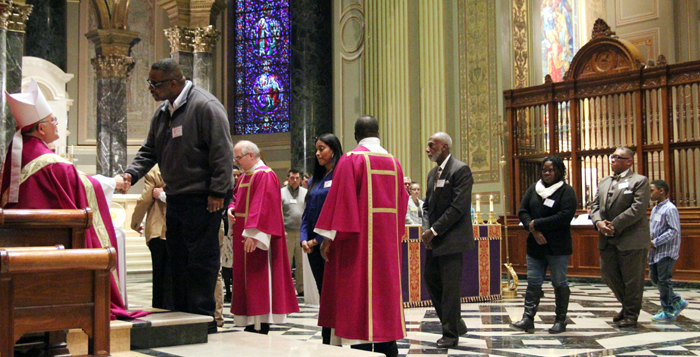 Archbishop Chaput receives those entering the Church.