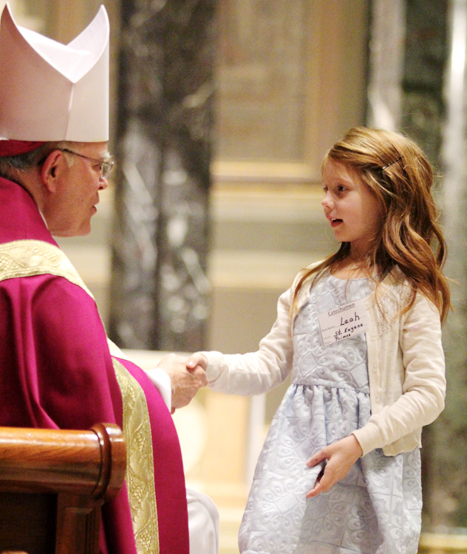 Archbishop Chaput welcomes Leah from Saint Eugene Parish in Primos, Delaware County.
