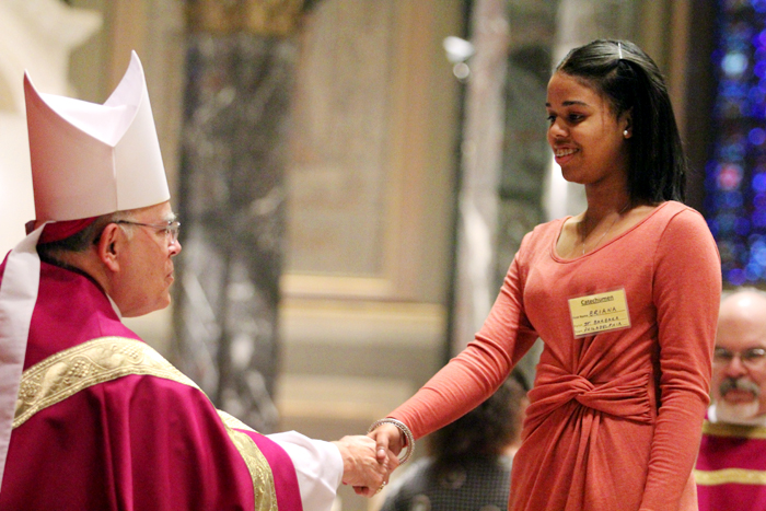 Archbishop Chaput welcomes catechumen Briana from Saint Barbara in Philadelphia to the Church.
