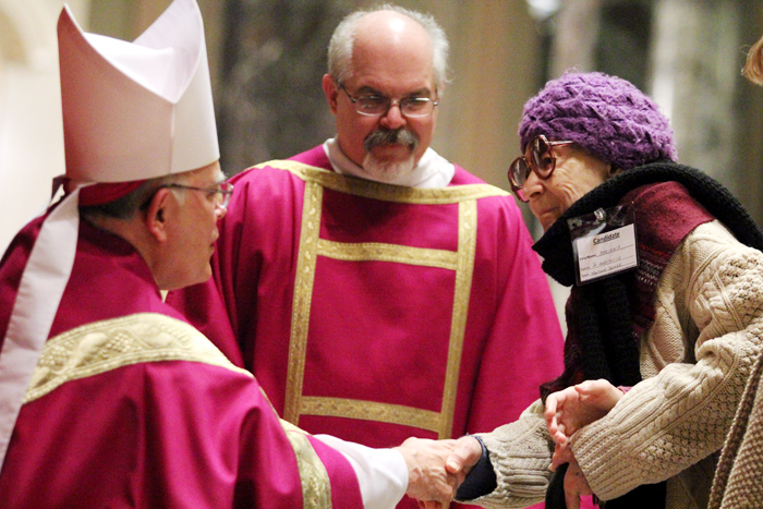 Archbishop Chaput welcomes candidate Mariana from Saint Anastasia Church in Newtown Square.