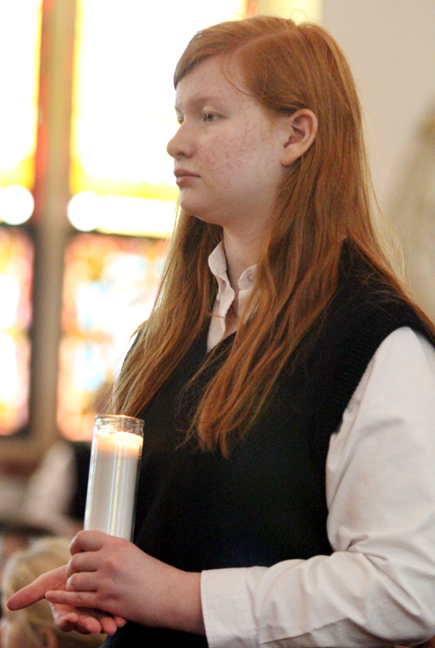 Eighth grader Cecelia Erndwein prays the rosary along with fellow students of Saint Aloysius School in Pottstown.