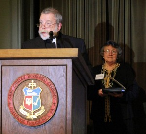 Father William Grogan, pastor of Holy Cross Parish in Philadelphia, accepts the Serra Club award for his father Bill Grogan who died last year.