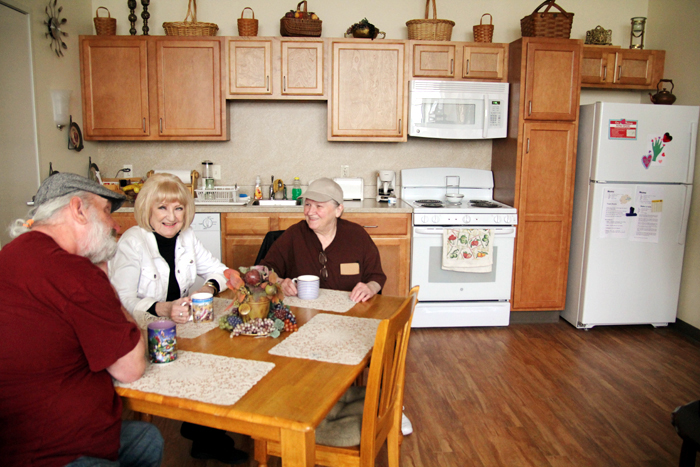 Residents of Nativity BVM Home Theresa Beckowski, Francis Hyduk and Mildred Roman enjoy a cup of coffee.