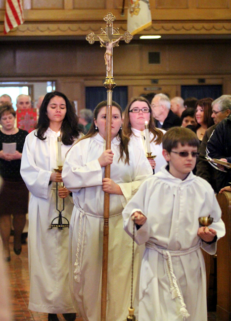 Thomas Ohrt leads the entrances procession for the 100th anniversary mass of Saint Joseph Church in Collingdale.