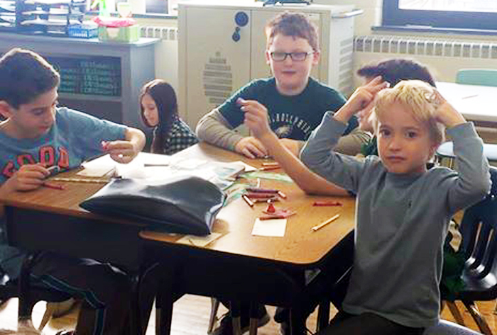 The prayer partners of St. Joseph the Protector School, Glenside, work on a project.