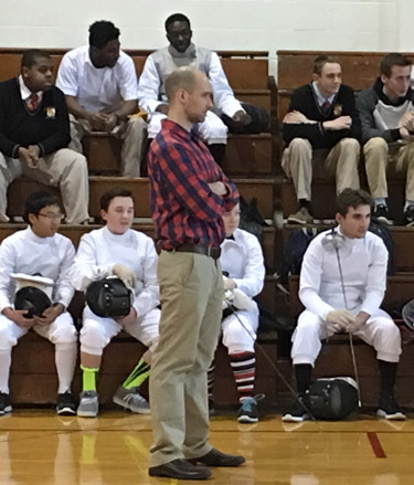 Archbishop Carroll fencing coach Brandon Lafving watches a recent match.