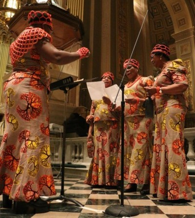 A group of women sing during the Mass, one of eight choirs singing sacred music in eight languages. (Mark A. Cordero)