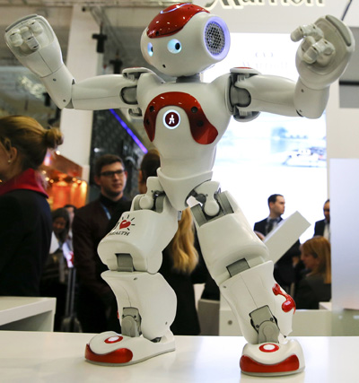 A Zora Bots humanoid robot dances at the Marriott exhibition stand on the International Tourism Trade Fair in Berlin March 9. (CNS photo/Fabrizio Bensch, Reuters)