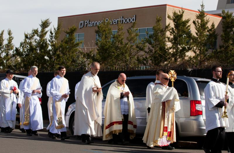 Denver Archbishop Samuel J. Aquila leads 1,800 Catholics in a eucharistic procession around Planned Parenthood in Denver March 5. (CNS photo/Andrew Wright, Denver Catholic)
