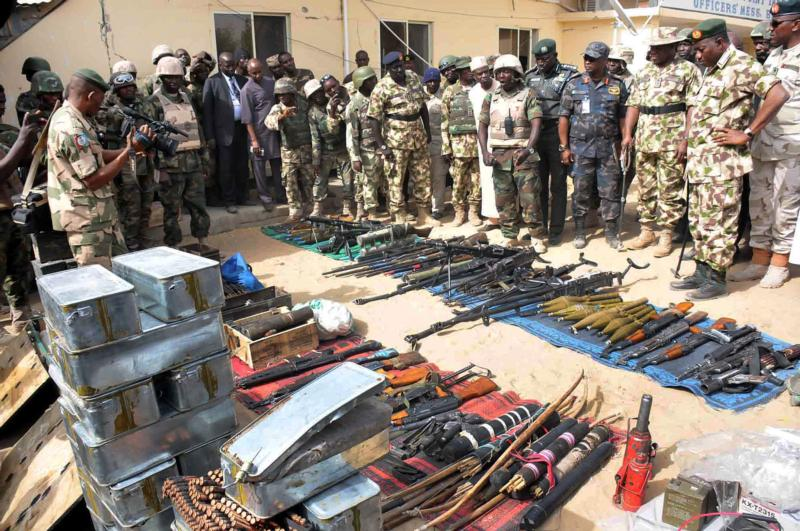 Nigerian President Goodluck Jonathan and military inspect weapons seized by Islamic militants in Baga, Nigeria, in this Feb. 26, 2015, file photo. (CNS photo/Stringer, EPA)