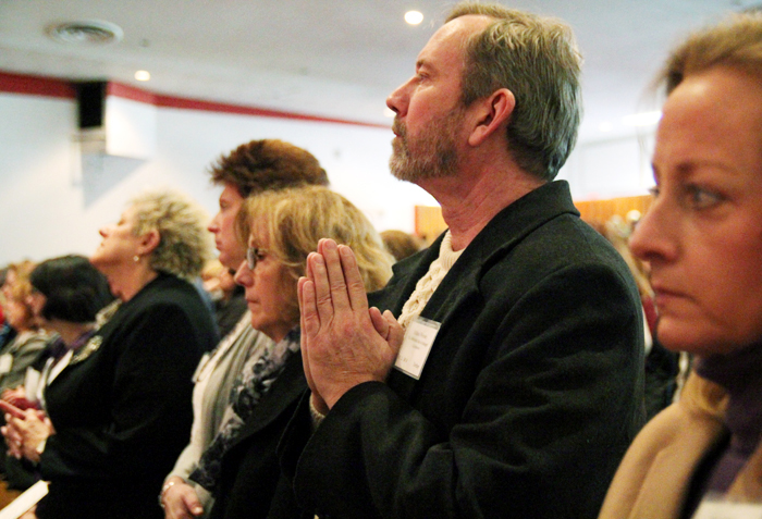 Alan Wersler, from Micheal the Archangel Parish in Levittown, prays with fellow catechists during mass that began the convocation.