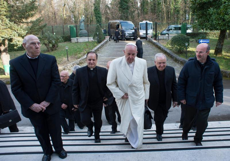 Pope Francis arrives for a weeklong Lenten retreat, flanked by Father Valdir Jose De Castro, superior general of the Society of St. Paul, Msgr. Leonardo Sapienza, regent of the papal household and several senior members of the Roman Curia in Ariccia, Italy, March 6. (CNS photo/L'Osservatore Romano, handout)