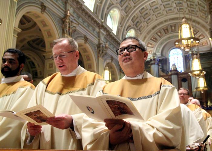 Fathers William Donovan and Efran Esmilla