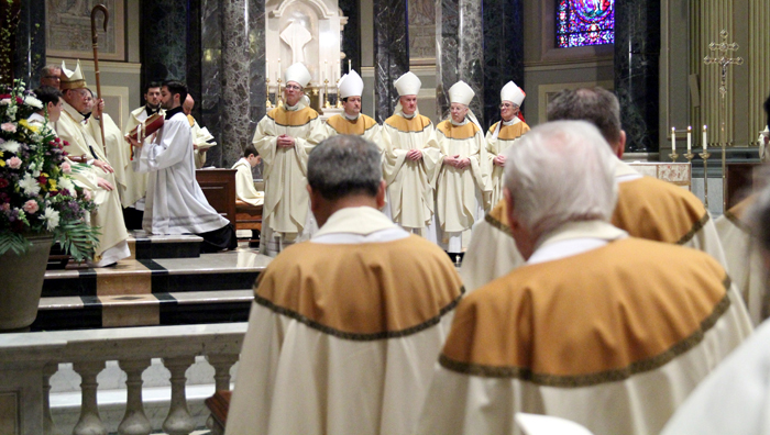 Archbisohp Charles Chaput leads Auxillary bishops Timothy Senior, John McIntyre, Michael Fitzgerald, Robert Maginnis and Louis DeSimone in renewal of their vows with the priest of the Archdiocese.