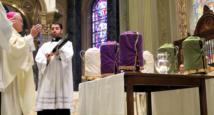 Archbishop Charles Chaput blesses the holy oils, to be used by priests in the sacraments of the church throughout the the year, during the Chrism Mass on Holy Thursday.