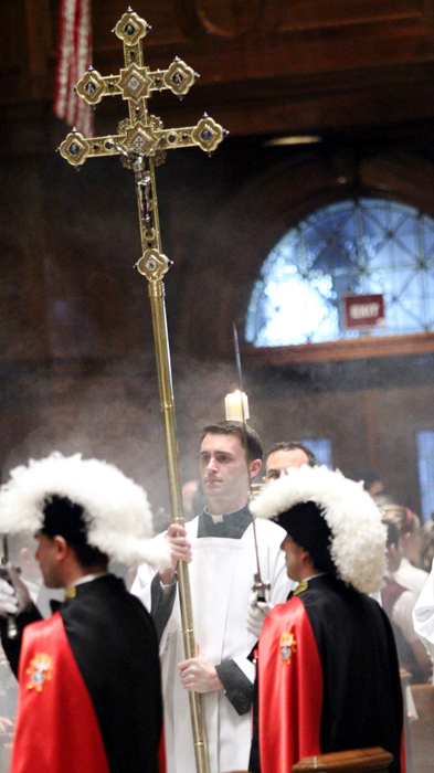 Seminarian David O'Brien leads the entrance procession of the Chrism Mass on Holy Thursday.