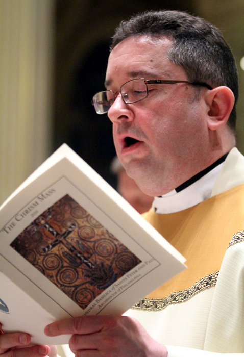 Father William Monahan, parochial vicar at Saint TImothy Church in Northeast Philadelphia, raises his voice in praise.