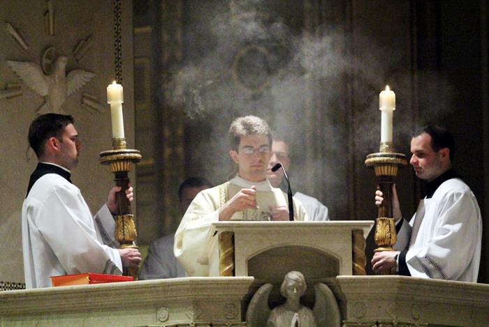 Deacon Matthew Biedrzycki proclaims the Gospel of the Lord.