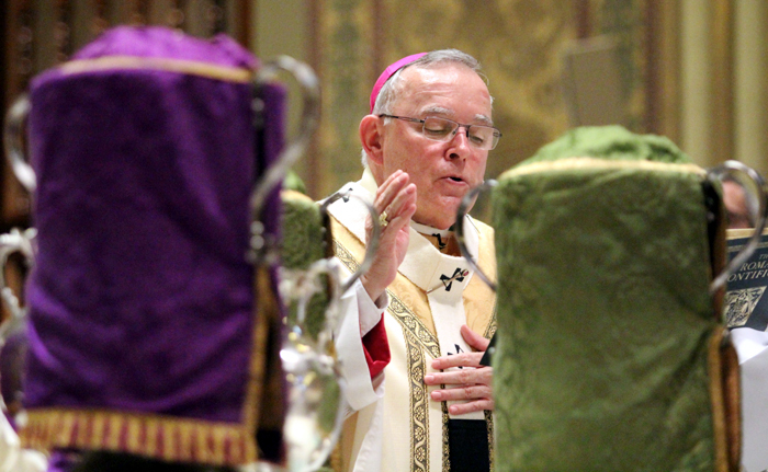 Archbishop Charles Chaput blesses the holy oils, to be used by priests in the sacraments of the church throughout the the year, during the chrism mass at the Cathedral Basillica of SS. Peter and Paul.
