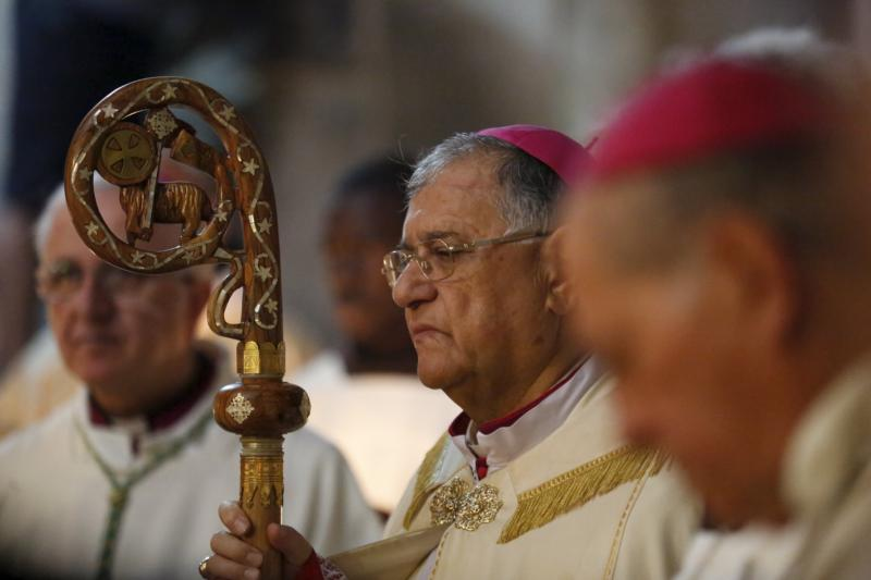 Latin Patriarch Fouad Twal of Jerusalem celebrates Easter Mass at the Church of the Holy Sepulcher in Jerusalem's Old City March 27. (CNS photo/Amir Cohen, Reuters)